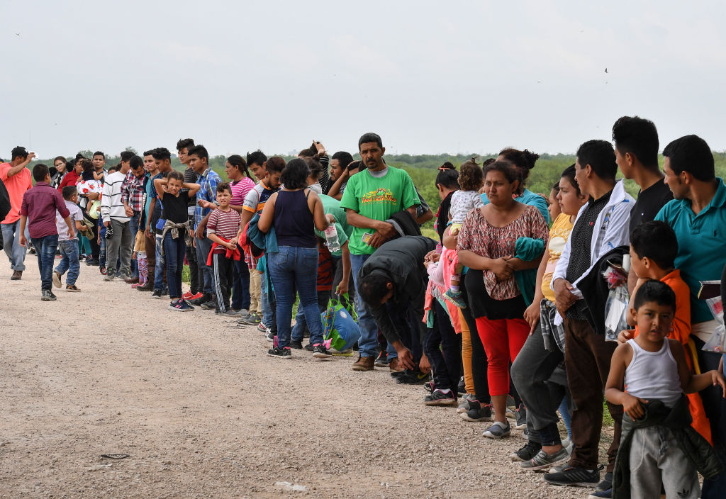 MCALLEN, TX - MAY 15: Undocumented migrants wait to be processe