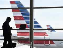 Viajero en aeropuerto/Susan Walsh/AP