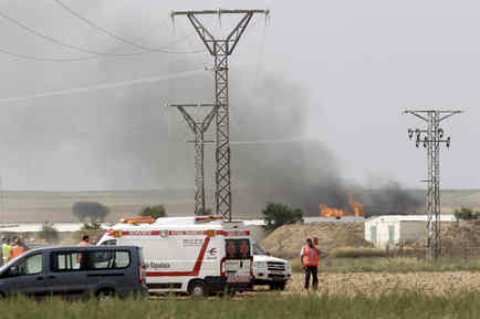Fire and smoke are seen at the scene of an explosion at a fireworks factory on the outskirts of Zaragoza