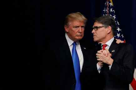 """U.S. President Donald Trump talks with Energy Secretary Rick Perry after delivering remarks during an """"Unleashing American Energy"""" event at the Department of Energy in Washington"""