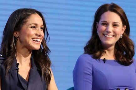 Kate Middleton y Meghan Markle sonriendo