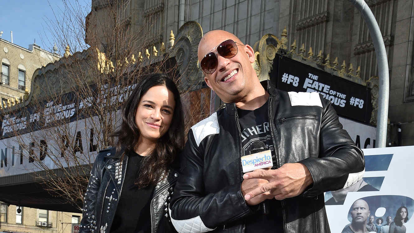 Michelle Rodriguez and Vin Diesel posing together on carpet