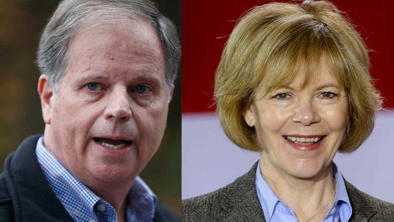 Doug Jones, senador electo por Alabama y Tina Smith, senadora electa por Minnesota