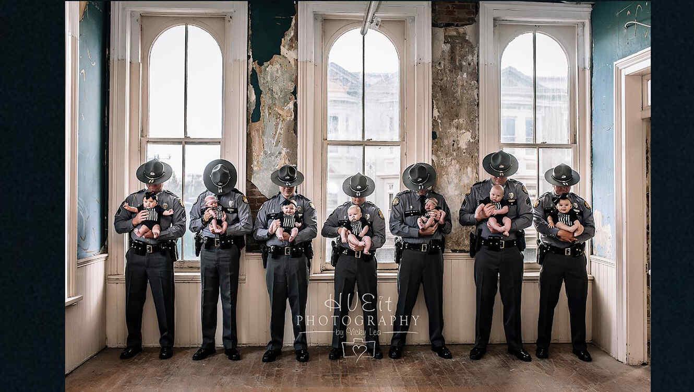 Kentucky Police Officers holding their newborns