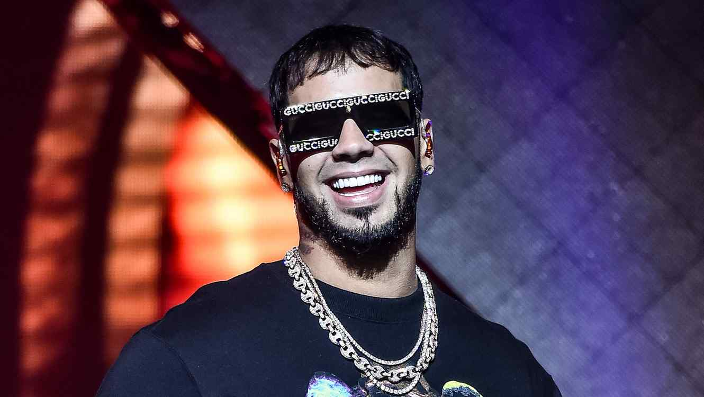 Anuel AA wearing Gucci sunglasses