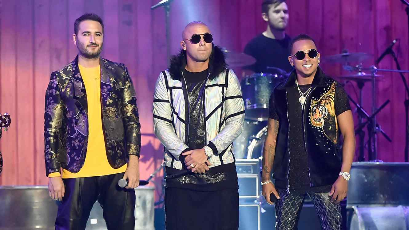 Reik, Wisin, and Ozuna onstage at the 2018 Billboard Latin Music Awards