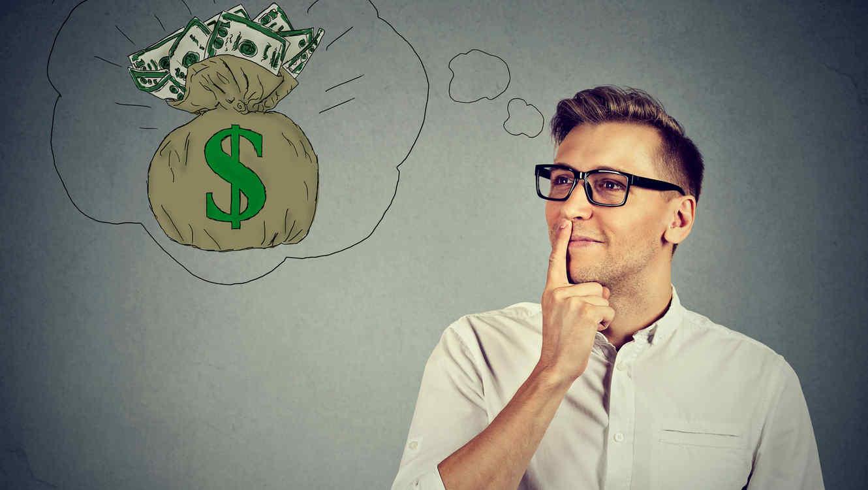 Hombre joven pensando en dinero