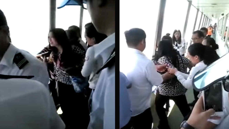 Una mujer intenta tirarse al océano para recuperar su teléfono (VIDEO)