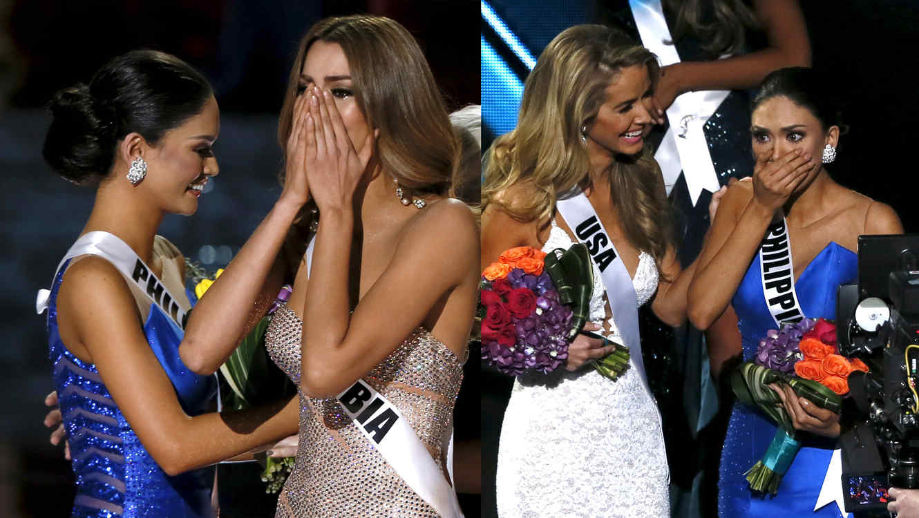 Miss Colombia Gutierrez stands by as Miss Universe 2014 places the sash on Miss Philippines  Wurtzbach during the 2015 Miss Universe Pageant in Las Vegas