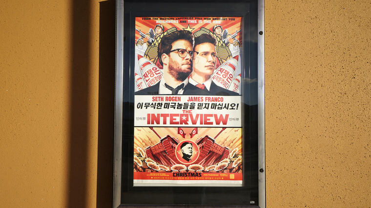 """The poster for the film """"The Interview"""" is seen outside the Alamo Drafthouse theater in Littleton"""