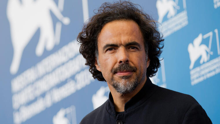 """FILE - In this Aug. 27, 2014 file photo, director Alejandro Inarritu poses during a photo call for the movie """"The Birdman"""" at the 71st edition of the Venice Film Festival in Venice, Italy. Inarritu was nominated for a Golden Globe for best director for the film on Thursday, Dec. 11, 2014. The 72nd annual Golden Globe awards will air on NBC on Sunday, Jan. 11. (AP Photo/Andrew Medichini, File)"""