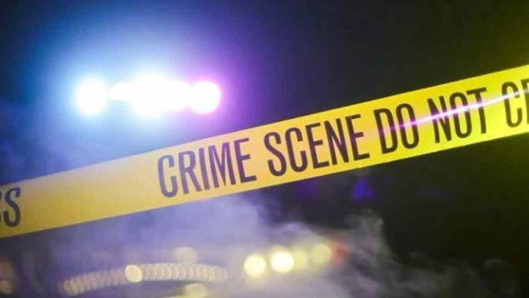 Un cordón de la policía en una escena del crimen.