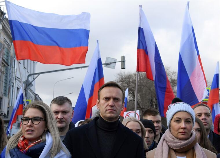 Alexei Navalny, al centro, en una protesta celebrada en el centro de Moscú, Rusia.