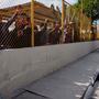 Migrantes tras la reja de un alberge temporal en Piedras Negras, México el 7 de febrero de 2019