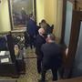 En esta imagen de un video de seguridad se ve al exvicepresidente Mike Pence siendo evacuado cuando los insurgentes se toman el Capitolio, durante el segundo juicio político del expresidente Donald Trump, en Washington, el 6 de febrero de 2021.
