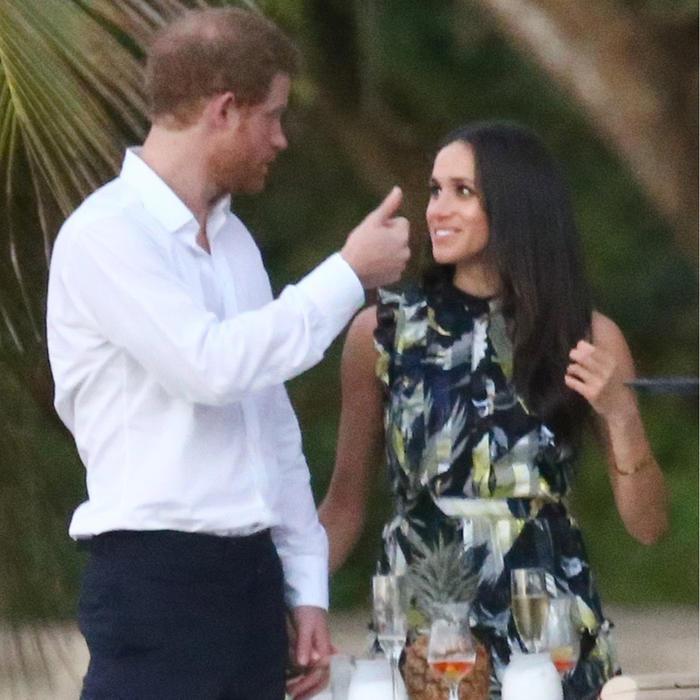Meghan Markle y el príncipe Harry hablando