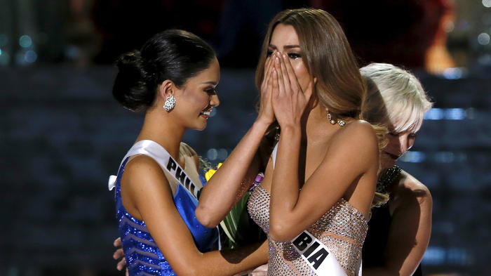 Miss Colombia Gutierrez reacts next to Miss Philippines Wurtzbach when she was originally announced as the winner during the 2015 Miss Universe Pageant in Las Vegas