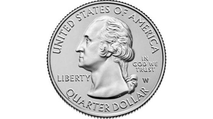 """Moneda con símbolo W bajo palabras """"In God We Trust"""""""