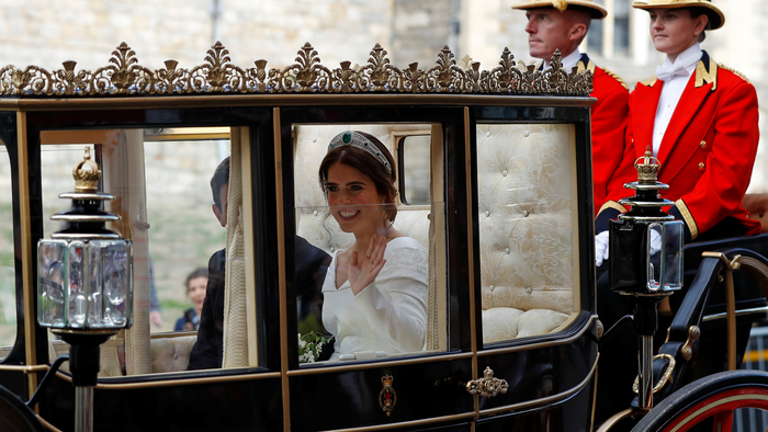 Britain's Princess Eugenie and Jack Brooksbank leave the St George's Chapel after their wedding at Windsor Castle, Windsor
