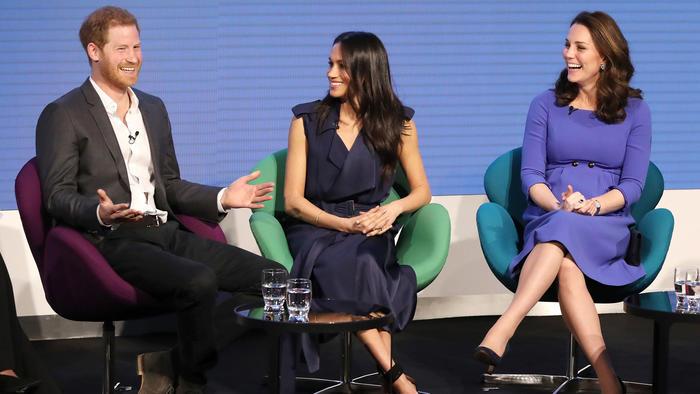 Príncipe Harry con Meghan Markle y Kate Middleton