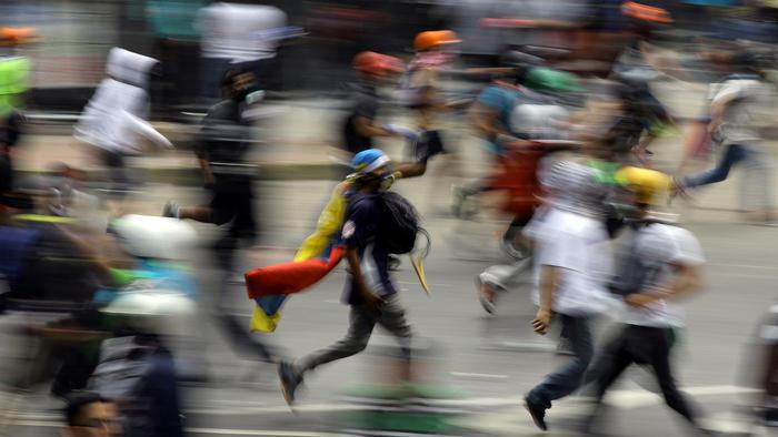 Protestantes en contra del gobierno en Venezuela