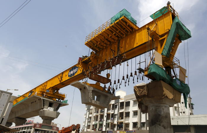 Labourers work at the site of metro railway flyover under construction in Ahmedabad