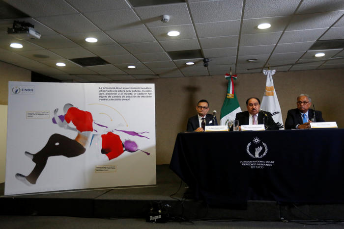 Members of special office in charge of the case Iguala from National Human Rights Commission (CNDH), take part in a news conference in Mexico City