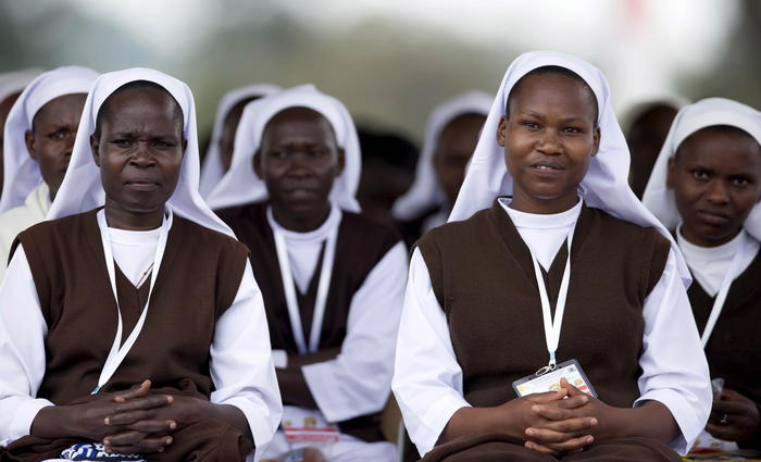 Nuns attend a mass by Pope Francis at the Kololo ceremonial grounds in Kampala, Uganda