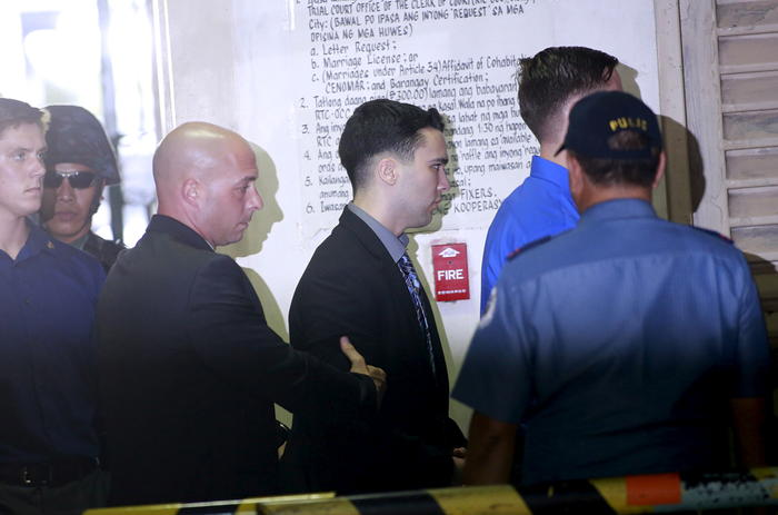U.S. Marine Lance Corporal Joseph Scott Pemberton is escorted by U.S. security into a court in Olongapo city, north of Manila
