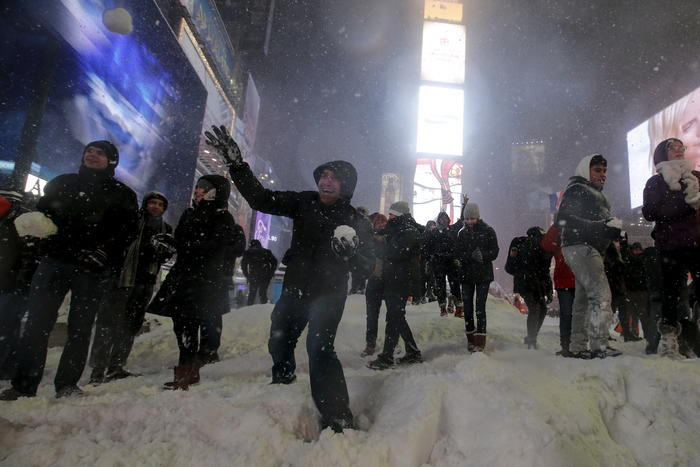 Dozens of people take part in an impromptu snow ball fight during a snow storm in Times Square in the Manhattan borough of New York