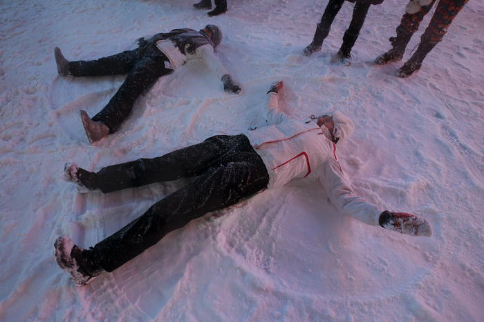 People make snow angels during a snow storm in Times Square in the Manhattan borough of New York