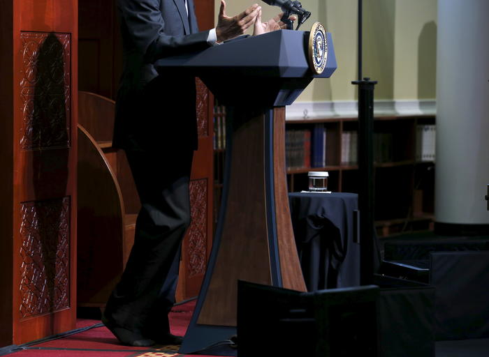 Obama goes without shoes, out of deference, as he delivers remarks at the Islamic Society of Baltimore mosque in Catonsville, Maryland
