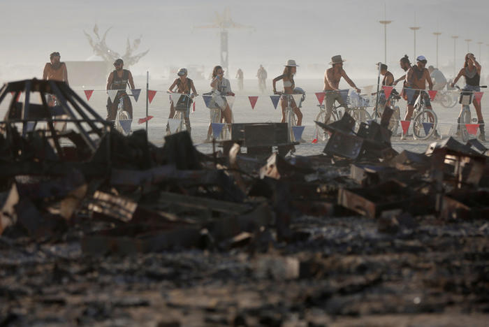 Participants gather at the remains of the Man as approximately 70,000 people from all over the world gathered for the annual Burning Man arts and music festival in the Black Rock Desert of Nevada