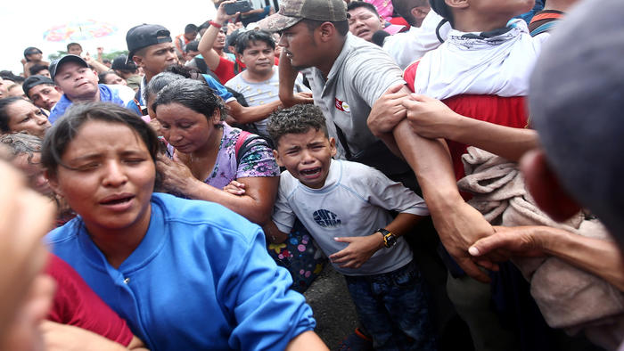 A Honduran migrant, part of a caravan trying to reach the U.S., cries after stormed a border checkpoint in Guatemala, in Ciudad Hidalgo
