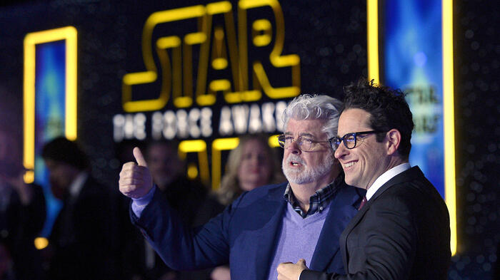 """Star Wars creator George Lucas (L) and director JJ Abrahms pose at the premiere of """"Star Wars: The Force Awakens"""" in Hollywood"""