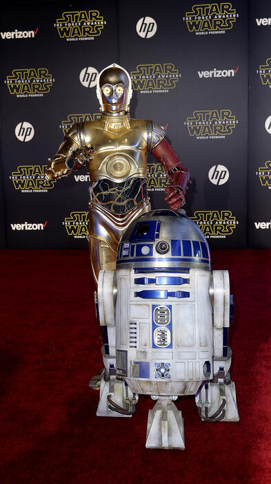 """C-3PO and R2-D2 arrive at the world premiere of the film """"Star Wars: The Force Awakens"""" in Hollywood"""