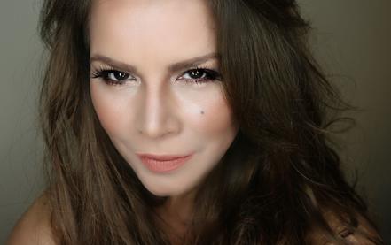 Olga Tañón sonriendo foto promocional