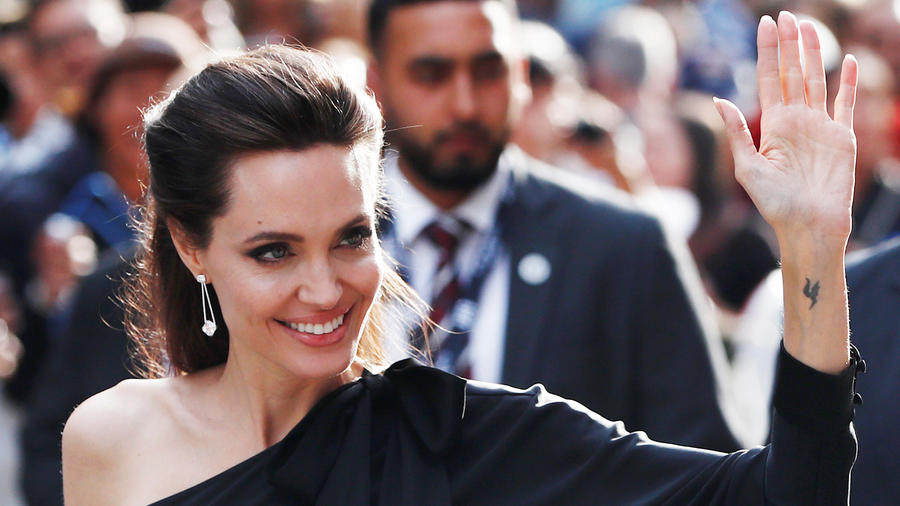 """Jolie arrives on the red carpet for the film """"First They Killed My Father"""" during the Toronto International Film Festival in Toronto"""