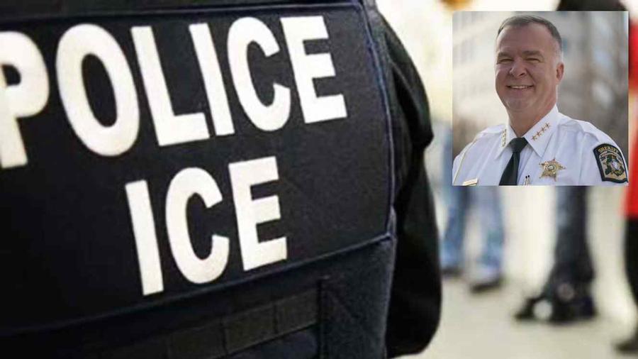 Un agente de ICE. En la esquina superior derecha, Irwin Carmichael.