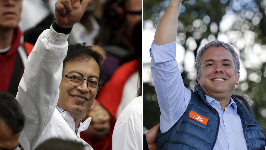 Los candidatos a la presidencia de Colombia Gustavo Petro, izquierda, e Iván Duque, derecha.