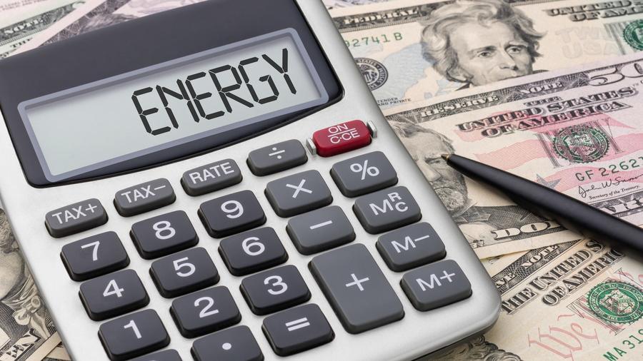 Dólares y calculadora con la palabra energy