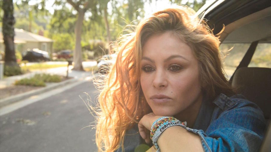 Paulina Rubio inside a car