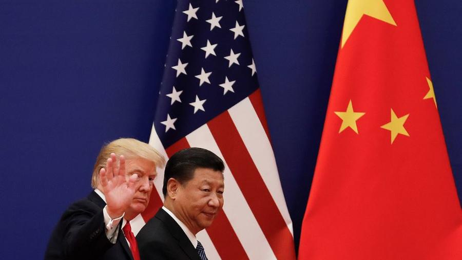 Donald Trump y el presidente chino Xi Jinping en un evento empresarial en Pekín en noviembre de 2017.