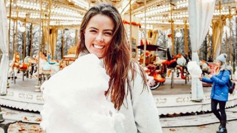 Nicole Peña sonriendo en uno de sus viajes