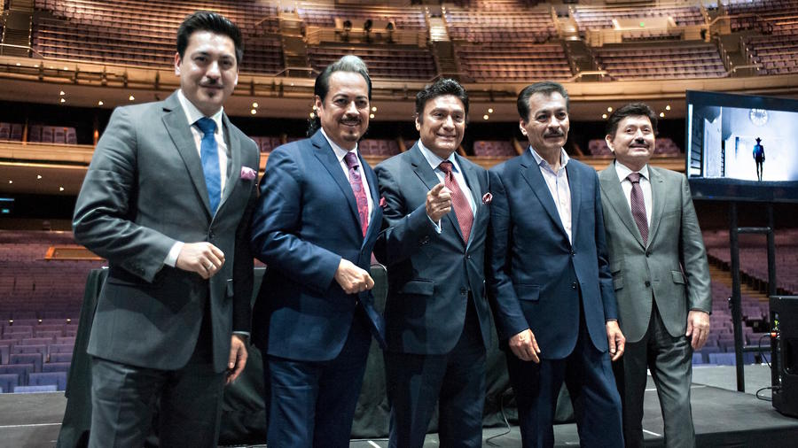Los Tigres del Norte pose during a press conference