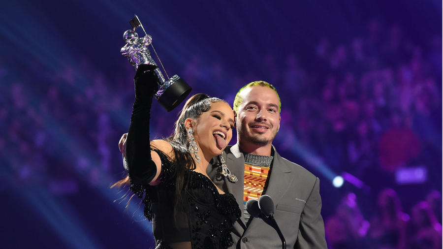 Rosalía and J Balvin speak onstage during the 2019 MTV Video Music Awards