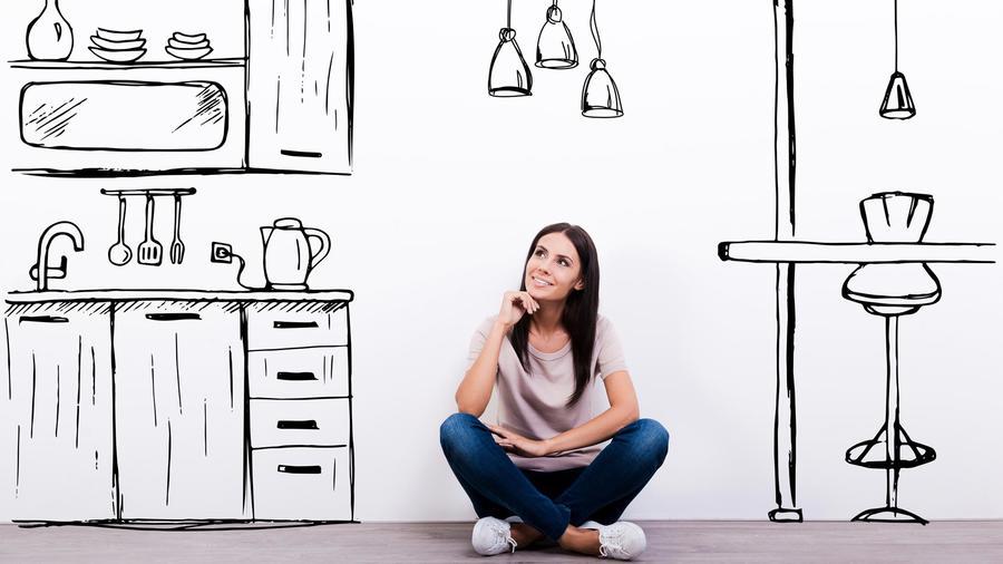Mujer sentada en una cocina dibujada