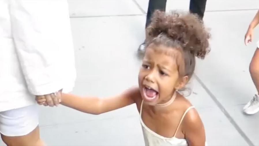 North West was not happy with the paparazzi.