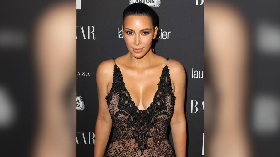 Kim Kardashian Flaunts Her Assets in a Sheer Lace Dress