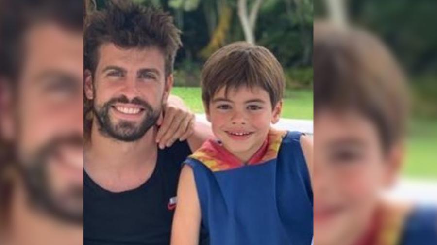 Gerard Piqué y Milan sonriendo